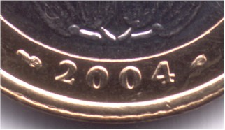 Privy marks about the date on a 500 Franc-CFA of 2004